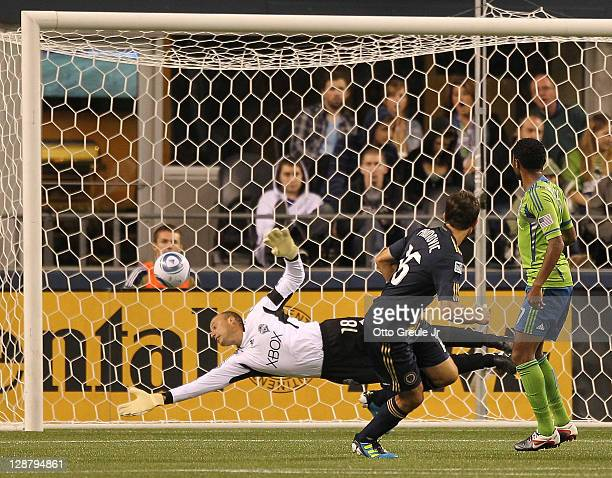 Goalkeeper Kasey Keller of the Seattle Sounders FC makes a save on a header shot by Veljko Paunovic of the Philadelphia Union at CenturyLink Field on...