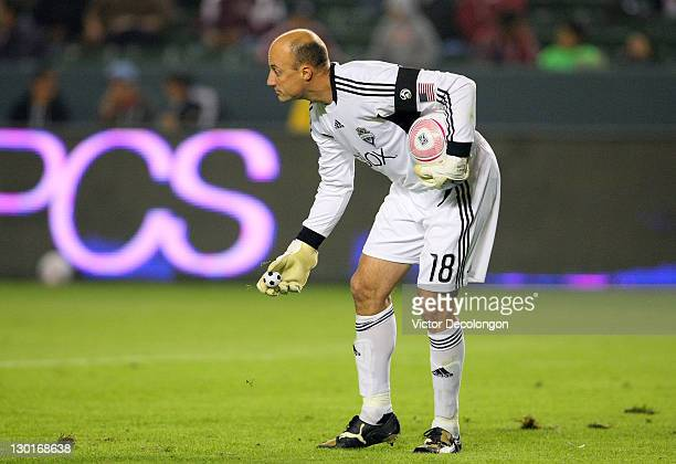 Goalkeeper Kasey Keller of the Seattle Sounders picks up a miniature soccer ball during a break in play in their MLS match against Chivas USA at The...