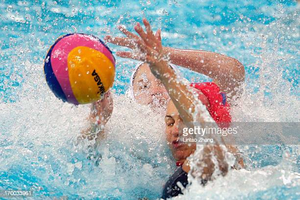 Goalkeeper Kaso Orsolya Hungary challenges Lauren Silver of United States during the Women's Water Polo Gold Medal match between the United States...