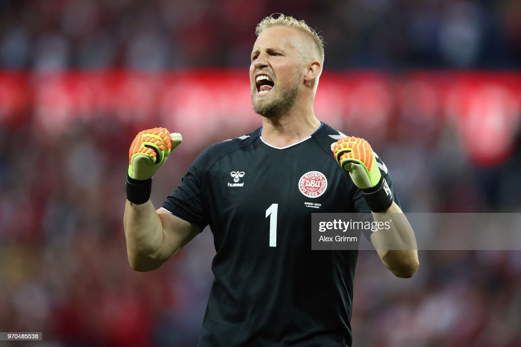 Goalkeeper Kasper Schmeichel of Denmark celebrates after teammate Yussuf Poulsen (not in frame) scores his team's first goal during the international friendly match between Denmark and Mexico ahead of the FIFA World Cup Russia 2018 at Brondby Stadion on June 9, 2018 in Brondby, Denmark.