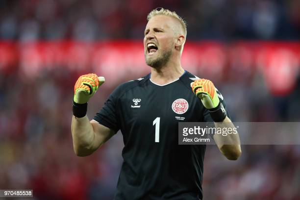 Goalkeeper Kasper Schmeichel of Denmark celebrates after teammate Yussuf Poulsen scores his team's first goal during the international friendly match...