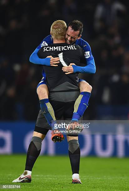 Goalkeeper Kasper Schmeichel of Leicester City and Christian Fuchs of Leicester City celebrate following their team's 21 victory during the Barclays...