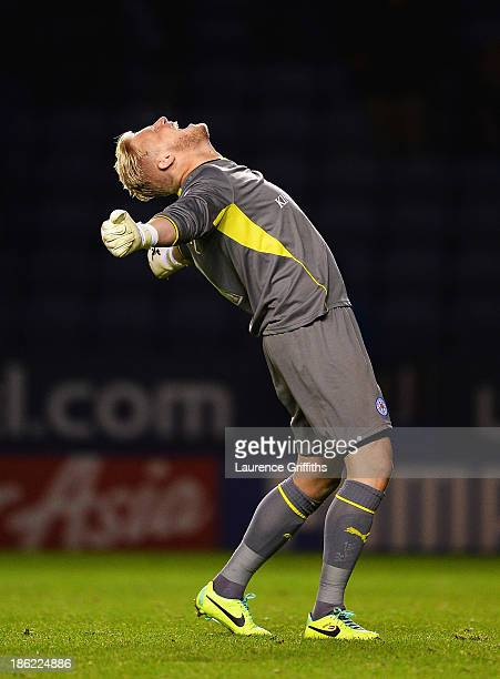 Goalkeeper Kasper Schmeichel of Leicester City celebrates the fourth Leicester goal during the Capital One Cup fourth round match between Leicester...