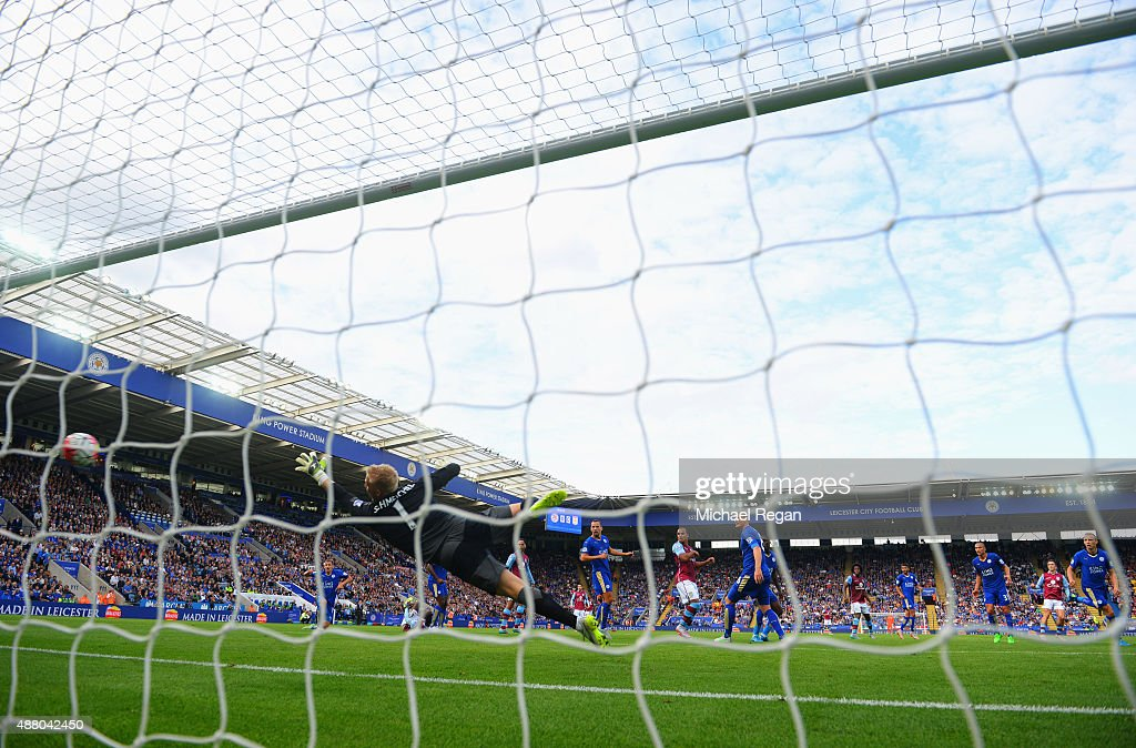 Goalkeeper Kasper Schmeichel of Leicester City fails to stop Jack Grealish of Aston Villa (2R) from scoring their first goal during the Barclays Premier League match between Leicester City and Aston Villa at the King Power Stadium on September 13, 2015 in Leicester, United Kingdom.