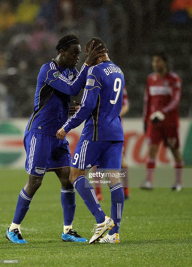 Goalkeeper Kei Kamara #23 of the Kansas City Wizards celebrates with Teal Bunbury #9 after scoring during the game against the Chicago Fire on May 15, 2010 at Community America Park in Kansas City, Kansas.