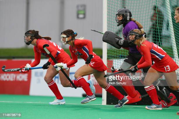 Goalkeeper Kelsey Bing and defenders of the United States guard the goal on a penalty shot against Argentina during the Women's FIH Field Hockey Pro...