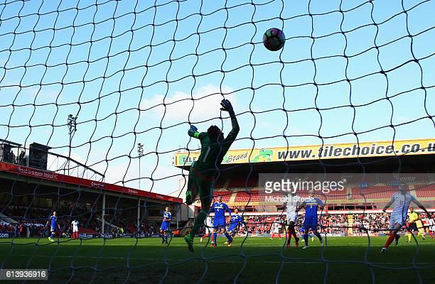 Goalkeeper Kenan Piric of Bosnia and Herzegovina U21 dives in vain as John Swift of England U21 scores thie first goal during the UEFA European U21...