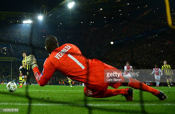 Goalkeeper Kenneth Vermeer of Ajax saves a penalty of Mats Hummels of Dortmund during the UEFA Champions League group D match between Borussia...