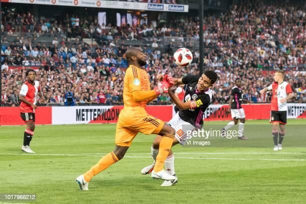 goalkeeper Kenneth Vermeer of Feyenoord Achraf El Mahdioui of AS Trencin during the UEFA Europa League third round qualifying second leg match...