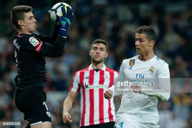 Goalkeeper Kepa Arrizabalaga of Athletic Club stops the ball strikes by Cristiano Ronaldo of Real Madrid CF during the La Liga match between Real...