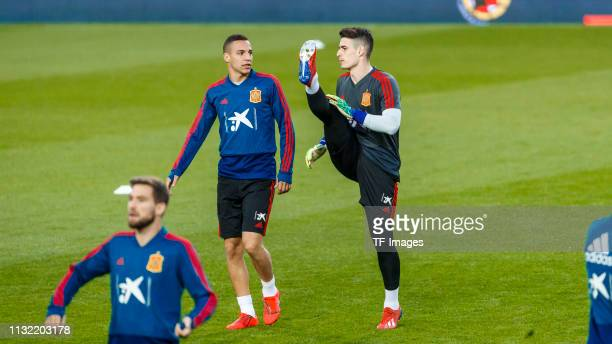 goalkeeper Kepa Arrizabalaga of Spain and Rodrigo Moreno of Spain gesture during the Spain training session at Mestalla Stadium on March 22 2019 in...