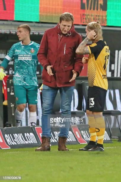 goalkeeper Kevin Broll of SG Dynamo Dresden and Marco Hartmann of SG Dynamo Dresden and Marvin Stefaniak of SG Dynamo Dresden speak with during the 3...