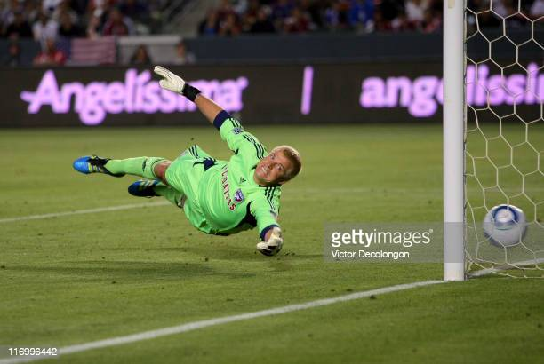 Goalkeeper Kevin Hartman of FC Dallas can't make the save as the ball goes into the net for a goal by Michael Lahoud of Chivas USA during their MLS...