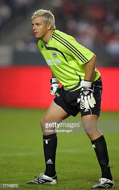 Goalkeeper Kevin Hartman of the Kansas City Wizards stands in position to defend his net in the second half of their Western Conference playoff game...