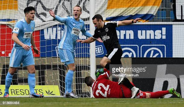 Goalkeeper Kevin Kunz of Chemnitz is fouled by Timo Mauer of Jena during the 3 Liga match between Chemnitzer FC and FC Carl Zeiss Jena at...