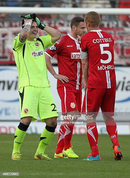 Goalkeeper Kevin Mueller celebrates the victory with Uwe Moehrle of Cottbus after the 3.Liga match between Energie Cottbus and SpVgg Unterhaching at...