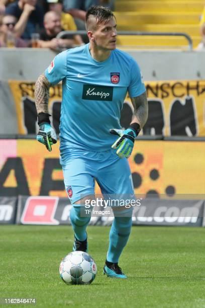 Goalkeeper Kevin Mueller of FC Heidenheim controls the ball during the Second Bundesliga match between SG Dynamo Dresden and 1. FC Heidenheim 1846 at...