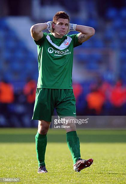 Goalkeeper Kevin Mueller of Rostock looks dejected after loosing the Second Bundesliga match between VfL Bochum and Hansa Rostock at Rewirpower...