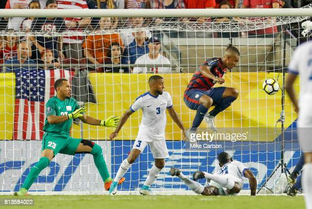 Goalkeeper Kevin Olimpa and defenders Antoine JeanBaptiste and Sebastien Cretinoir of Martinique and Juan Agudelo of the United States watch a goal...