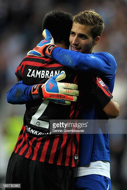 Goalkeeper Kevin Trapp of Frankfurt and teammate Carlos Zambrano hug after the Bundesliga match between Eintracht Frankfurt and Bayer 04 Leverkusen...