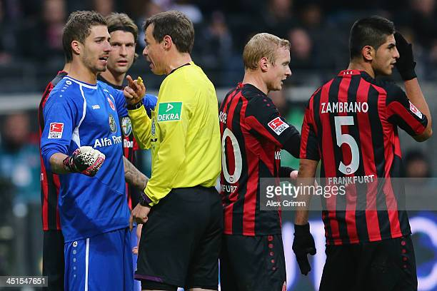 Goalkeeper Kevin Trapp of Frankfurt discusses with referee Markus Schmidt during the Bundesliga match between Eintracht Frankfurt and FC Schalke 04...