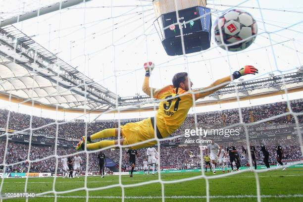Goalkeeper Kevin Trapp of Frankfurt fails to save a freekick from Milot Rashica of Bremen during the Bundesliga match between Eintracht Frankfurt and...