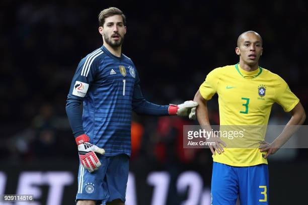 Goalkeeper Kevin Trapp of Germany and Miranda of Brazil during the international friendly match between Germany and Brazil at Olympiastadion on March...