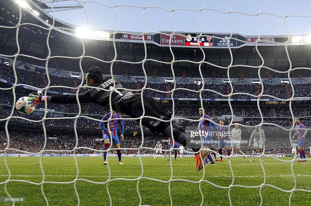 Goalkeeper Keylor Navas of Levante misses to save the opening goal from Cristiano Ronaldo of Real Madrid during the La Liga match between Real Madrid and Levante UD at Estadio Santiago Bernabeu on March 9, 2014 in Madrid, Spain.