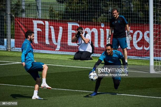 Goalkeeper Keylor Navas of Real Madrid CF stops the ball strikes by his teammate Francisco Roman Alarcon alias Isco during a training session held...
