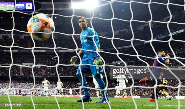 Goalkeeper Keylor Navas of Real Madrid reacts as Luis Suarez of FC Barcelona celebrates his team's third goal during the Copa del Rey Semi Final...