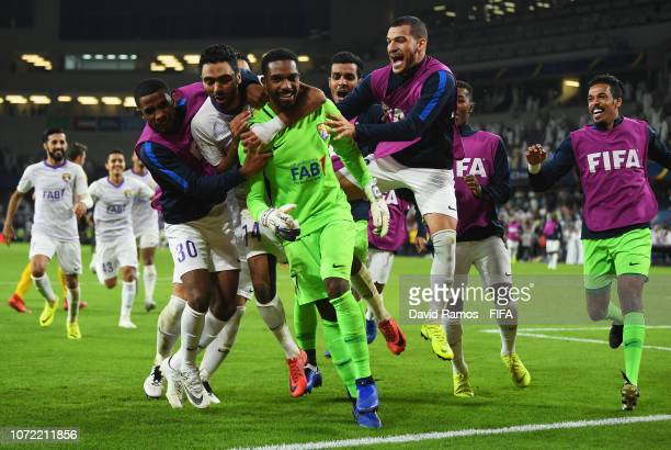 Goalkeeper Khalid Eisa of Al Ain celebrates penalty shoot victory with team mates after during the FIFA Club World Cup first round playoff match...
