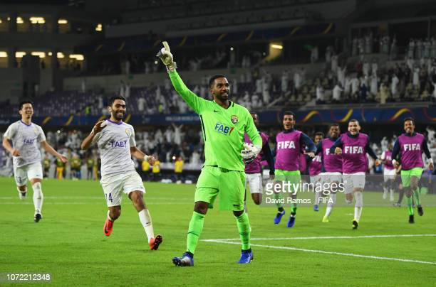 Goalkeeper Khalid Eisa of Al Ain celebrates penalty shoot victory with team mates after the FIFA Club World Cup first round play-off match between Al...