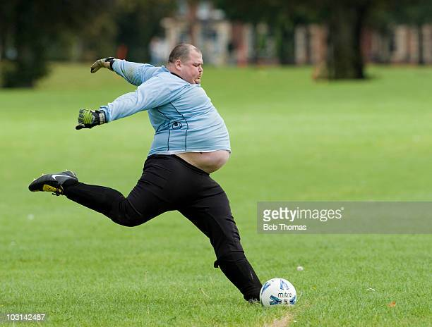 A goalkeeper kicking the ball during a Sunday morning football match on the Racecourse in Northampton 5th September 2009