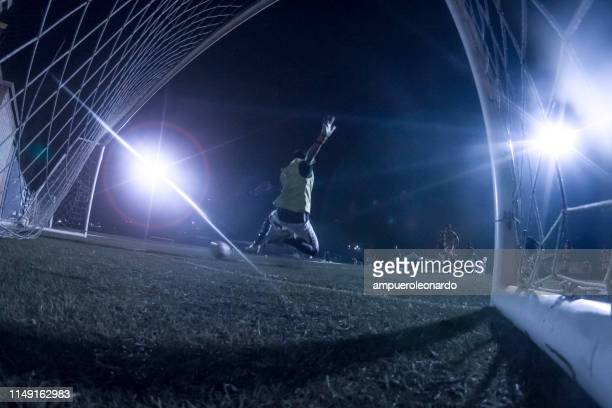 goalkeeper kicks the ball in a night stadium - penalty kick stock pictures, royalty-free photos & images