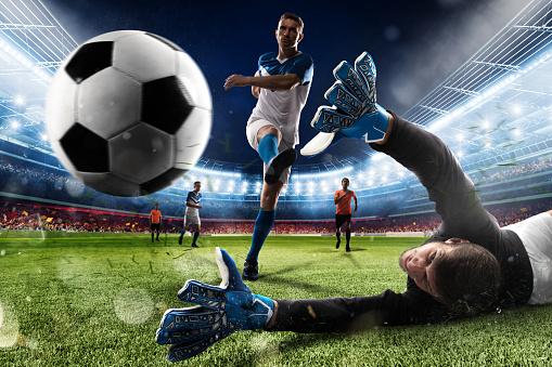 Goalkeeper kicks the ball in the stadium 874211776