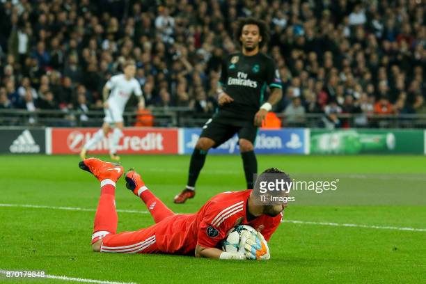 goalkeeper Kiko Casilla of Real Madrid controls the ball during the UEFA Champions League group H match between Tottenham Hotspur and Real Madrid at...