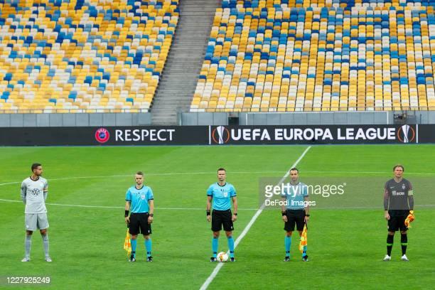 Goalkeeper Koen Casteels of VfL Wolfsburg, referee Ivan Kruzliak and goalkeeper Andriy Pyatov of Shakhtar Donetsk look on prior to the UEFA Europa...