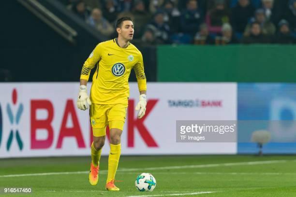 Goalkeeper Koen Casteels of Wolfsburg controls the ball during the DFB Cup match between FC Schalke 04 and VfL Wolfsburg at VeltinsArena on February...