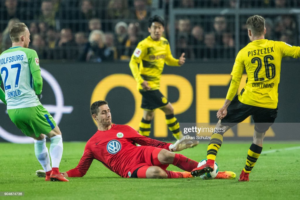 Goalkeeper Koen Casteels (C) of Wolfsburg in action against Lukasz Piszczek (R) of Dortmund during the Bundesliga match between Borussia Dortmund and VfL Wolfsburg at Signal Iduna Park on January 14, 2018 in Dortmund, Germany.