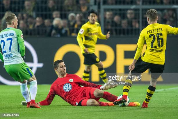 Goalkeeper Koen Casteels of Wolfsburg in action against Lukasz Piszczek of Dortmund during the Bundesliga match between Borussia Dortmund and VfL...