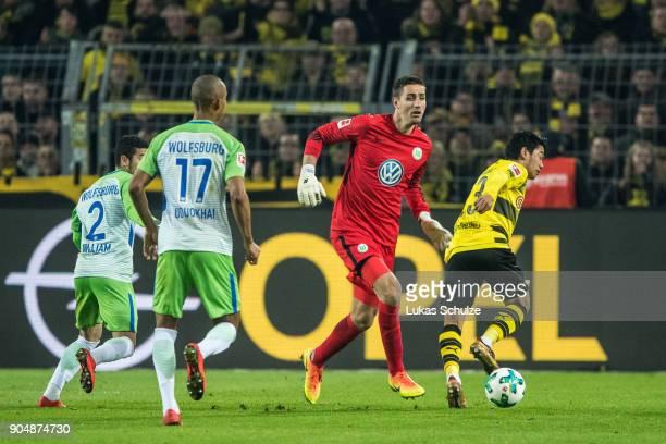 Goalkeeper Koen Casteels of Wolfsburg in action against Shinji Kagawa of Dortmund during the Bundesliga match between Borussia Dortmund and VfL...