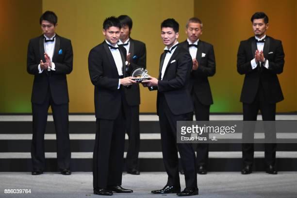 Goalkeeper Kosuke Nakamura of Kashiwa Reysol receives the Best Eleven Award from boxer Ryota Murata during the 2017 JLeague Awards at Yokohama Arena...