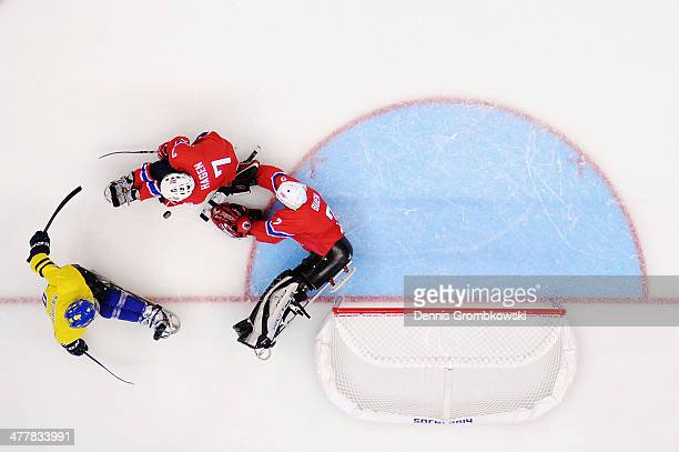 Goalkeeper Kristian Buen of Norway stretches for the puck during the Ice Sledge Hockey Preliminary Round Group A match between Norway and Sweden...