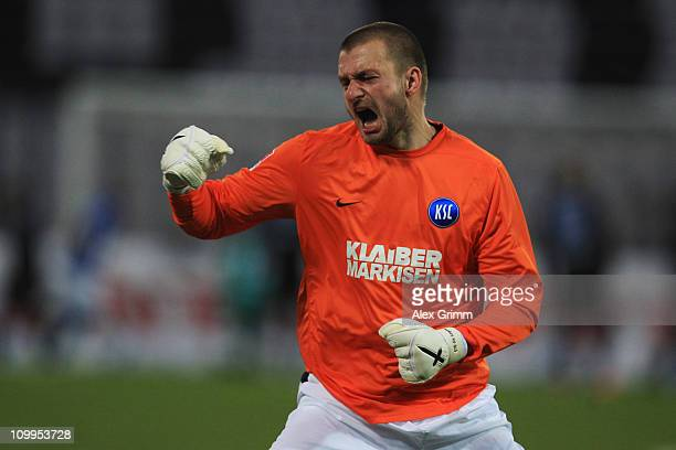 Goalkeeper Kristian Nicht of Karlsruhe celebrates after Aleksandr Iashvili scored his team's second goal during the Second Bundesliga match between...