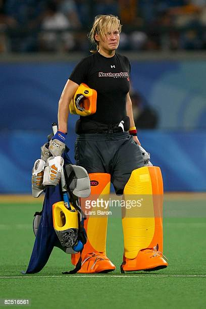 Goalkeeper Kristina Reynolds of Germany walks off the field after Argentina won the women's bronze medal hockey match 31 at the Olympic Green Hockey...