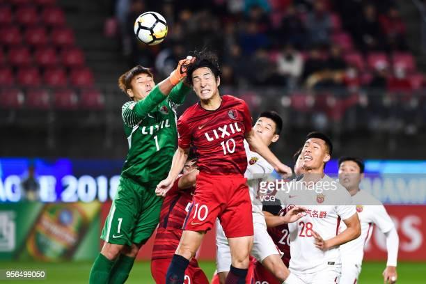 Goalkeeper Kwoun SunTae and Mu Kanazaki of Kashima Antlers saves the ball during the AFC Champions League Round of 16 first leg match between Kashima...