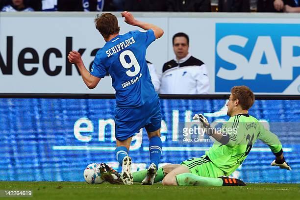 Goalkeeper Lars Unnerstall of Schalke fouls Sven Schipplock of Hoffenheim for a penalty during the Bundesliga match between 1899 Hoffenheim and FC...