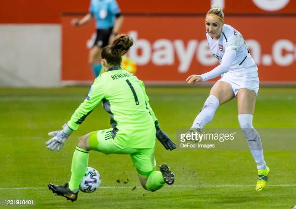Goalkeeper Laura Benkarth of FC Bayern Munich and Emma Berglund of FC Rosengard battle for the ball during the First Leg of the UEFA Women's...