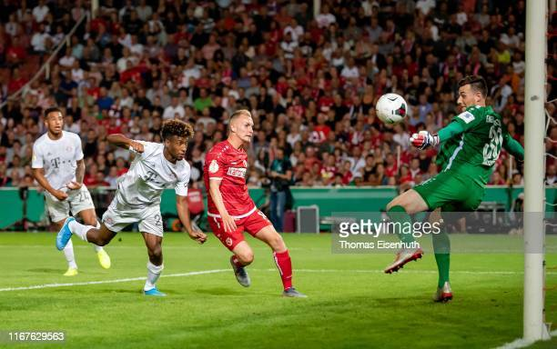 Goalkeeper Lennart Moser of Cottbus saves a header by Kingsley Coman of Muenchen during the DFB Cup first round match between Energie Cottbus and FC...