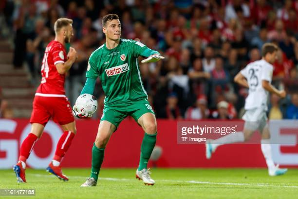 Goalkeeper Lennart Moser of Energie Cottbus controls the ball during the DFB Cup first round match between Energie Cottbus and FC Bayern Muenchen at...